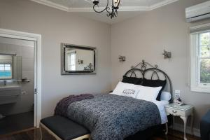 A bed or beds in a room at The Ark Stanley Luxury Bed and Breakfast