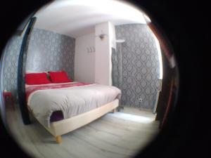 A bed or beds in a room at Le Tanneur, au coeur de Ribeauvillé