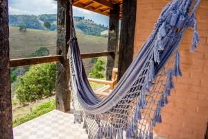 Uma varanda ou terraço em Pousada Cabanas no Mundo