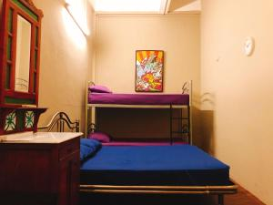 A bunk bed or bunk beds in a room at Backpacker Cozy Corner Guesthouse (SG Clean)