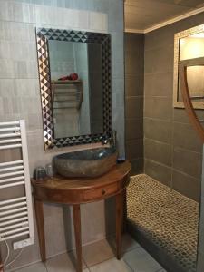 Salle de bains dans l'établissement La Caz Oceane