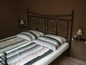 Ein Bett oder Betten in einem Zimmer der Unterkunft Ferienwohnung Clauss