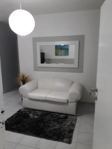 A seating area at Isla Verde Apt