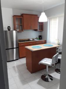 A kitchen or kitchenette at Isla Verde Apt