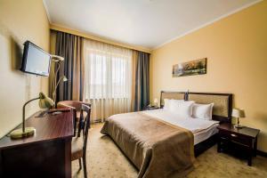 Cama o camas de una habitación en Hotel Minsk