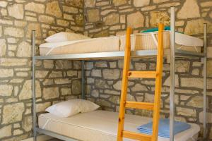 A bunk bed or bunk beds in a room at Himara Hostel