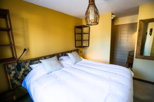 A bed or beds in a room at Safari Resort Beekse Bergen