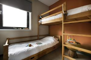 A bunk bed or bunk beds in a room at Safari Resort Beekse Bergen