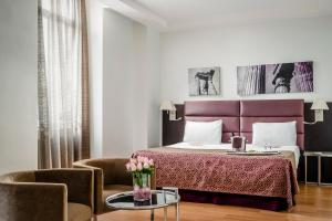A bed or beds in a room at Eurostars Roma Aeterna
