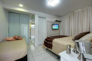 A bed or beds in a room at Villa Beira Mar