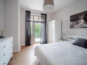 Ein Bett oder Betten in einem Zimmer der Unterkunft City Apartments Siegburg