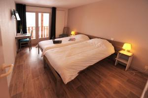 Un ou plusieurs lits dans un hébergement de l'établissement Les Balcons Du Lac d'Annecy - Néaclub