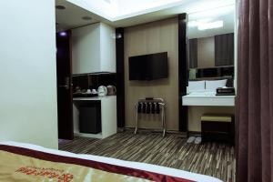 A television and/or entertainment center at Harmonious Hotel