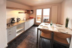 Cuisine ou kitchenette dans l'établissement Les Balcons Du Lac d'Annecy - Néaclub