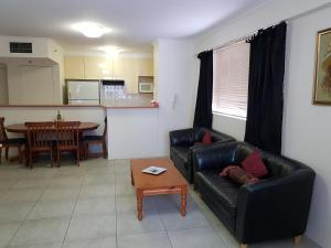 A seating area at Accommodation Sydney - Pitt Street