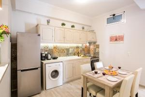 A kitchen or kitchenette at Penelope Corfu Suite