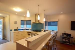 A kitchen or kitchenette at Bridport Holiday Rental