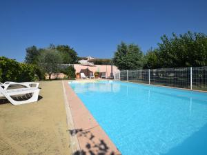 The swimming pool at or near Cozy Holiday Home in Uzer with Swimming Pool