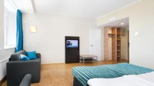 Телевизор и/или развлекательный центр в Hestia Hotel Seaport Tallinn