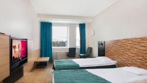 Кровать или кровати в номере Hestia Hotel Seaport Tallinn