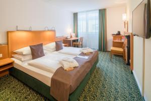 Ein Bett oder Betten in einem Zimmer der Unterkunft Best Western Hotel München Airport