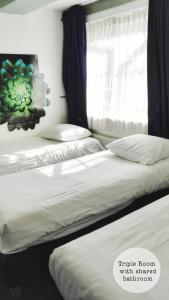 A bed or beds in a room at Rembrandt Square Hotel