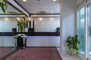 The lobby or reception area at Suite Hotel Elite