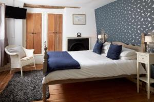 A bed or beds in a room at The Stag at Stow