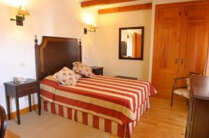 A bed or beds in a room at Casa de Campo Sao Rafael - Turismo Rural