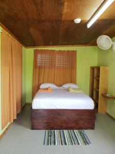 A bed or beds in a room at Sea n sun Guest House