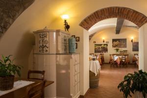 Ein Restaurant oder anderes Speiselokal in der Unterkunft Agriturismo Al Picchio