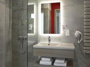A bathroom at ibis Styles Warszawa City