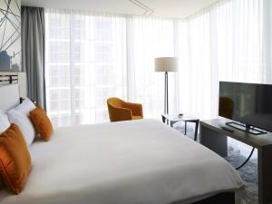 A bed or beds in a room at ibis Styles Warszawa City