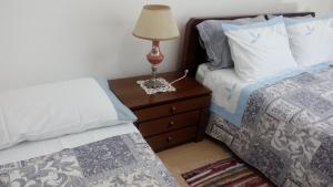 A bed or beds in a room at House Fiorela