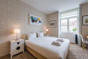A bed or beds in a room at TPC Infante Apartment by Douro River