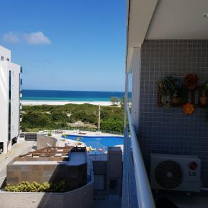 A view of the pool at Praia Grande Arraial do Cabo or nearby