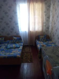 Кровать или кровати в номере Sosnoviy Bor Lodge