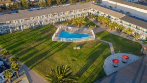 A view of the pool at San Simeon Lodge or nearby