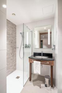 A bathroom at Hampton By Hilton Warsaw Mokotow