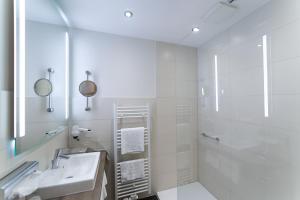 Ein Badezimmer in der Unterkunft AKZENT Hotel Thiemann