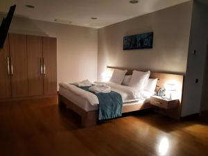 A bed or beds in a room at Maison Boutique Hotel