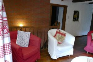 A bed or beds in a room at B&B La Pommeraie