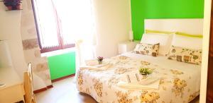 Un ou plusieurs lits dans un hébergement de l'établissement Tre Archi B&B