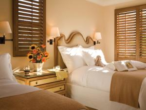 A bed or beds in a room at Resort at Pelican Hill