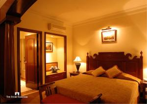 A bed or beds in a room at The Ffort Raichak