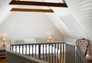 Säng eller sängar i ett rum på Torsborgs Gård