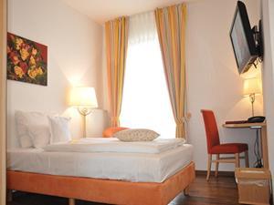 Ein Bett oder Betten in einem Zimmer der Unterkunft Golfpark Strelasund