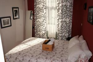 A bed or beds in a room at Porto Wine Hostel
