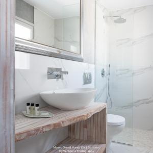 Salle de bains dans l'établissement Museo Grand Hotel