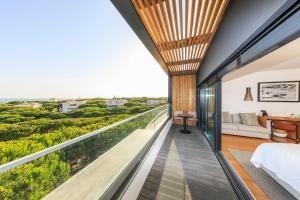 A balcony or terrace at Praia Verde Boutique Hotel